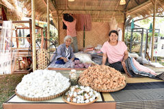 Woman working at the manufacturer of cotton. BANGKOK, THAILAND, DISCOVER THAINESS 2015, January 14, 2015: Woman working at the manufacturer of cotton. on Royalty Free Stock Photos