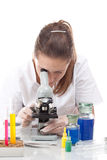 Woman working with a microscope Royalty Free Stock Photo