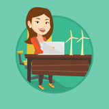 Woman working with model of wind turbines. Royalty Free Stock Photos