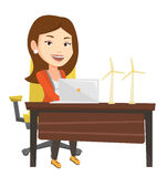 Woman working with model of wind turbines. Royalty Free Stock Images