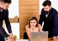 Woman working in mostly male collective. Intentional sexual provocation. Woman attractive lady working with men. Colleagues. Office atmosphere concept. Sexual royalty free stock photo