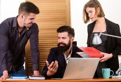 Woman working in mostly male workplace. Woman attractive lady working with men colleagues. Office collective concept. Coworkers communicate solving business royalty free stock photography