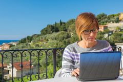 Woman working with netbook outdoors Stock Photo