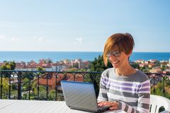 Woman working with netbook outdoors Stock Image