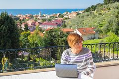 Woman working with netbook outdoors Royalty Free Stock Photo
