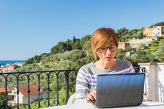 Woman working with netbook outdoors Royalty Free Stock Photos