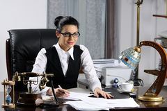 Woman working in office. Single beautiful manager woman smiling and working in office Royalty Free Stock Image