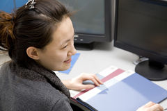 Woman working in office Stock Images