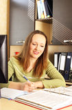 Woman working at the office. Attractive young woman working at the office Royalty Free Stock Photography
