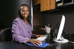 Woman working in office stock photos