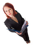 Woman working in the office. Young and attractive woman working in the office, keeps a folder in the hand Stock Images