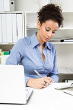 Woman working in office. Attractive woman working in office Royalty Free Stock Images