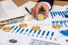 Woman working at office - bitcoin business graph, laptop royalty free stock images