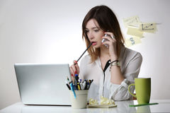 Woman working at office desk Stock Photos