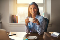Woman working at office drinking coffee Royalty Free Stock Images