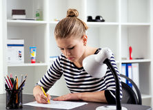 Woman working in the office Stock Image