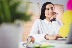 Woman working in office. Focused young woman working in office stock photos