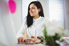 Woman working in office. Smiling young woman working in office Stock Photography