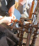 woman working in the old spinning wheel wool Royalty Free Stock Photo