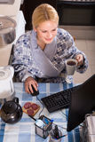 Woman working online at home Royalty Free Stock Image
