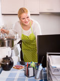 Woman working online at home Royalty Free Stock Photography