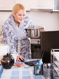 Woman working online at home Royalty Free Stock Photo
