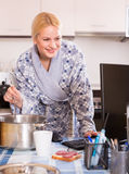 Woman working online at home Stock Photography