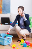 Woman working and organising toys Royalty Free Stock Images