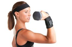 Woman Working Out. With dumbbells at a gym Stock Photo