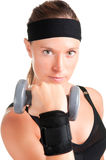 Woman Working Out. With dumbbells at a gym Royalty Free Stock Photos