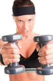 Woman Working Out. With dumbbells at a gym Stock Photography