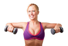 Woman Working Out. With dumbbells at a gym Stock Images