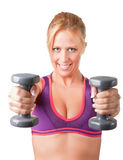 Woman Working Out. With dumbbells at a gym Royalty Free Stock Images