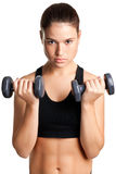 Woman Working Out. With dumbbells at a gym Stock Image