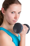 Woman Working Out. With dumbbells at a gym, isolated in a white background Royalty Free Stock Photo