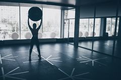 Woman working out with ball in gym stock photos