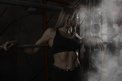 Woman working out with barbell Royalty Free Stock Photo