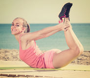 Woman working out in beach stock image