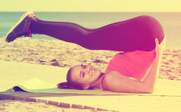 Woman working out in beach Stock Images