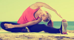 Woman working out in beach Royalty Free Stock Photo