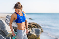Woman working out at the beach Stock Photo