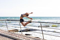 Woman working out at the beach. Young sporty woman working out at the beach Royalty Free Stock Photography