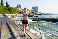 Woman working out at the beach. Young sporty woman working out at the beach Stock Images