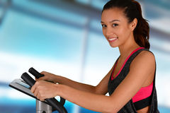 Woman Working Out On Bike Royalty Free Stock Image
