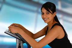 Woman Working Out On Bike stock image