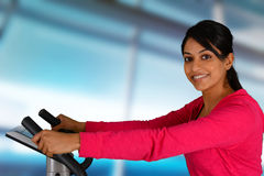 Woman Working Out On Bike Stock Images