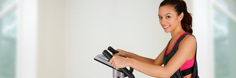 Woman Working Out On Bike. Woman working out while at the gym on bike Stock Images