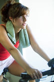 Woman working out in bike Stock Photos