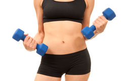 Woman working out with blue dumbbells weights Royalty Free Stock Photos