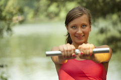 Woman working out with dumbbell Stock Photos